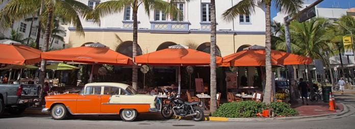08 art deco ocean drive edison orange car umbrellas 1 1046x380