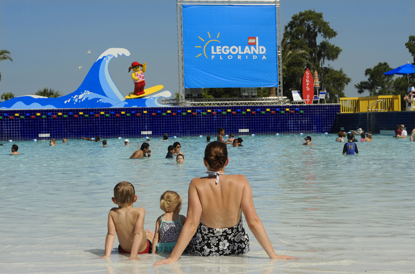 WINTER HAVEN, Florida (May 26, 2012) .Summer officially kicked off at LEGOLAND Florida this morning as the theme park opened its all-new water park attraction.  General Manager Adrian Jones cut the ribbon and got a surprise soaking from a 300-gallon bucket of water while hundreds of kids took the first splash at the Joker Soaker water playground. (PHOTO/LEGOLAND Florida, Merlin Entertainments Group, Brian Blanco).