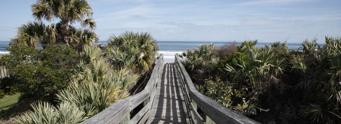 Walkways lead to the oasis awaiting those who are looking for surf, sand and serenity...Tucked on Central Florida's Atlantic coast, New Smyrna Beach, is comprised of spectacular natural experiences and a laid back atmosphere. Vacationers relish in the tranquil ambiance as well as day-trippers from Orlando. (Photo/Julie Fletcher)