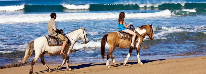 BYT011 Horseback riders at Las Marias beach in Rincon Puerto Rico