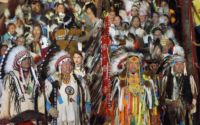 Dancers from tribal nations begin to enter the arena Friday, April 28, 2006, in Albuquerque, N.M., for the beginning of the 2006 Gathering of Nations Pow Wow. (AP Photo/Albuquerque Journal, Roberto E. Rosales)